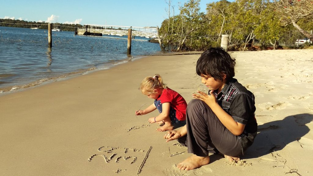 Markito doing some maths and Freyja drawing with sticks on the beach at Karragarra Island. 15 July 2017