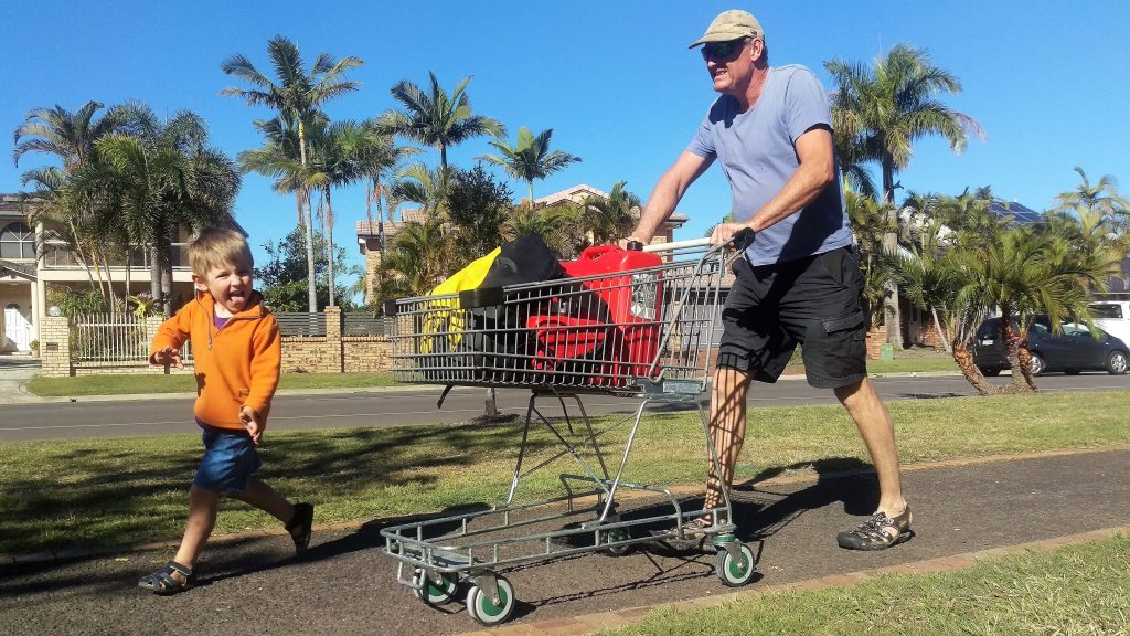 Simon pushing the shopping trolley that's carrying our heavy jerry cans full of petrol. Zach providing encouragement and entertainment. 21 July 2017