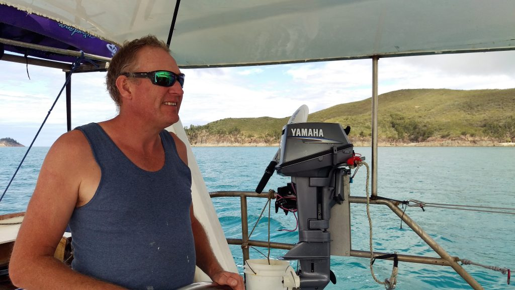 Simon at the helm guiding us into our protected anchorage at Cape Capricorn.